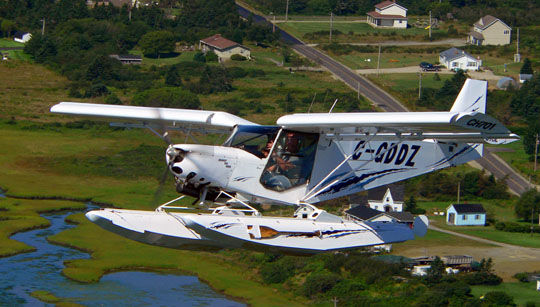 Brad d'Entremont flying by in his float plane (Ted D'Eon photo)